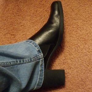 Black leather slip on shoe boots